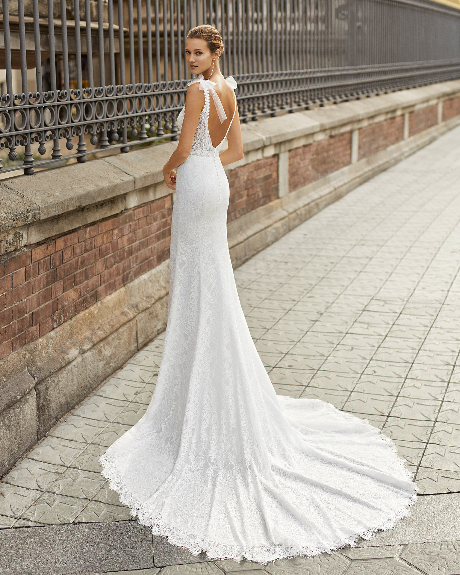 Mermaid wedding dress, beaded lace. V-neck, bows on the shoulders, low back and dot tulle bows on the shoulders. 2022  Collection.