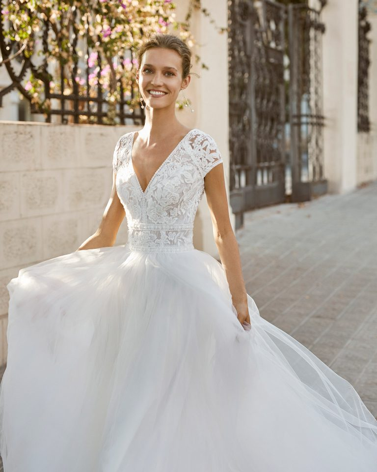 Romantic wedding dress, tulle, lace and beaded neckline, back, armholes and waist. With V-neck and V-back. 2022  Collection.
