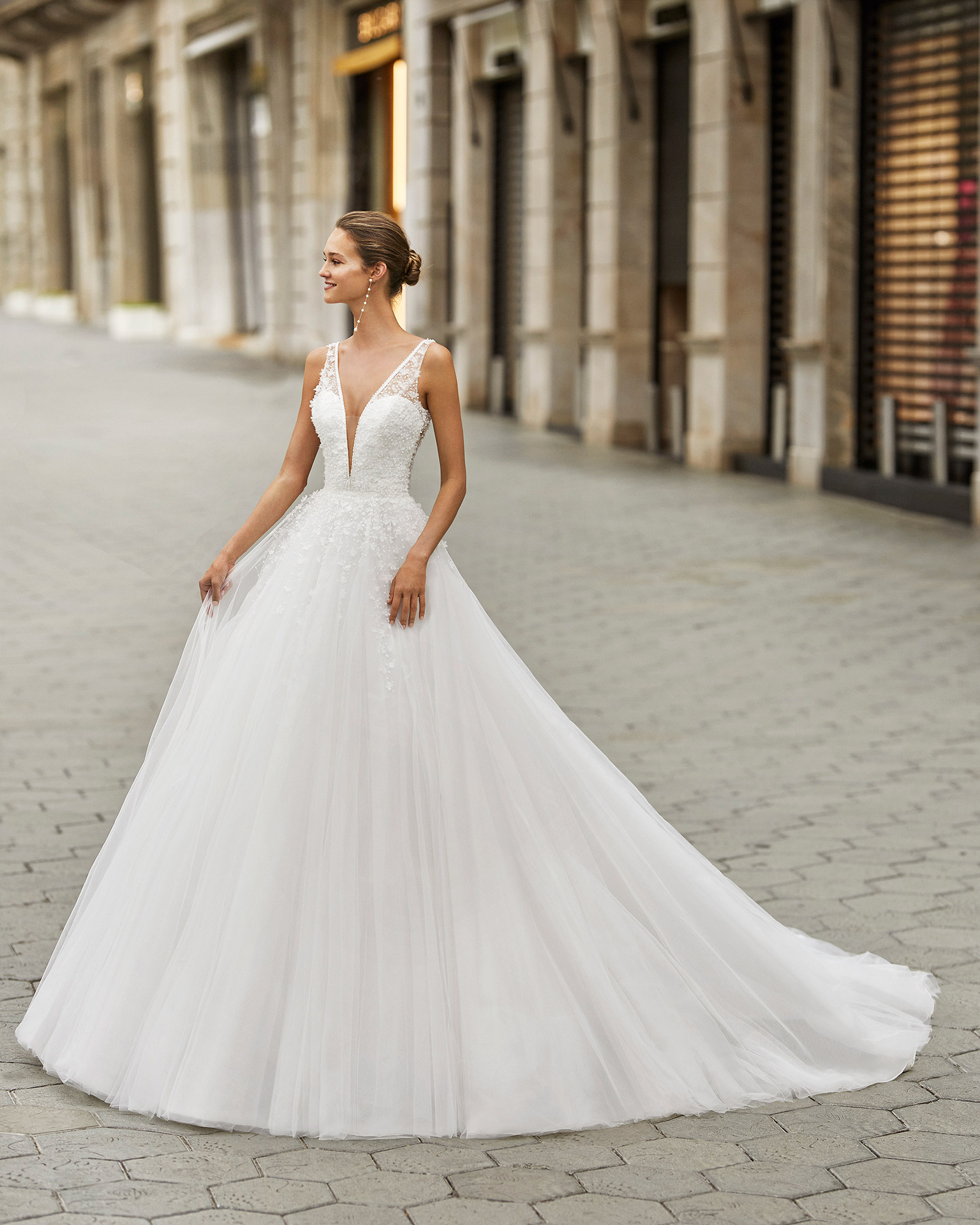 Romantic wedding dress, beaded tulle. Deep-plunge neckline and V-back. 2022  Collection.