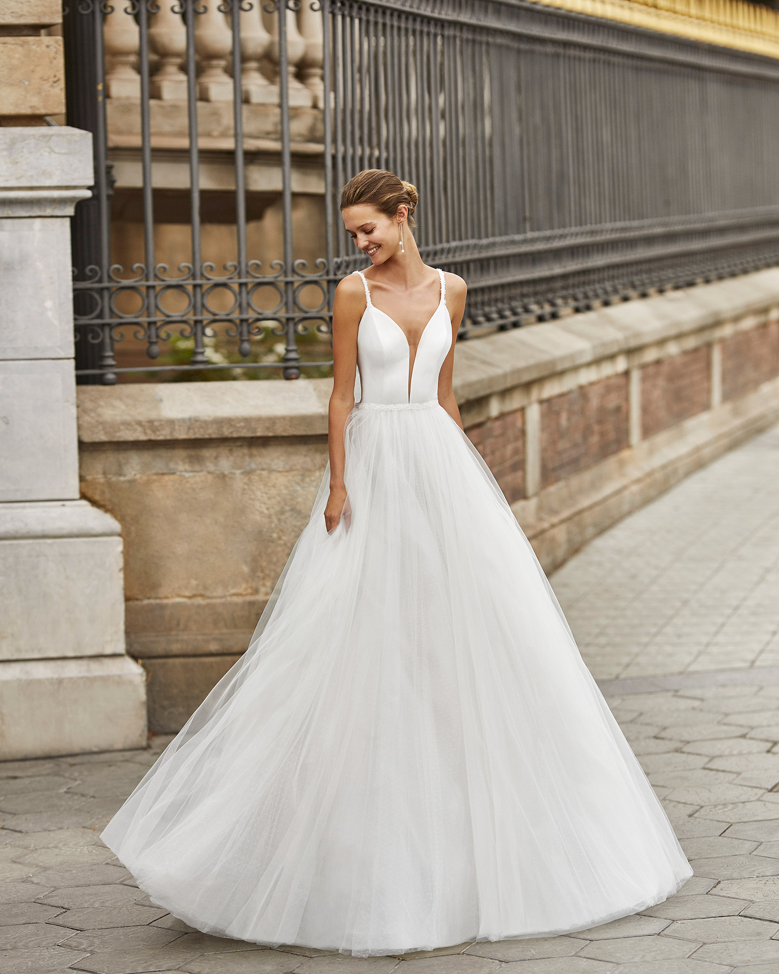 Princess wedding dress, tulle and dot tulle underskirt, crepe and beaded straps and waist. Deep-plunge neckline and low back. 2022  Collection.