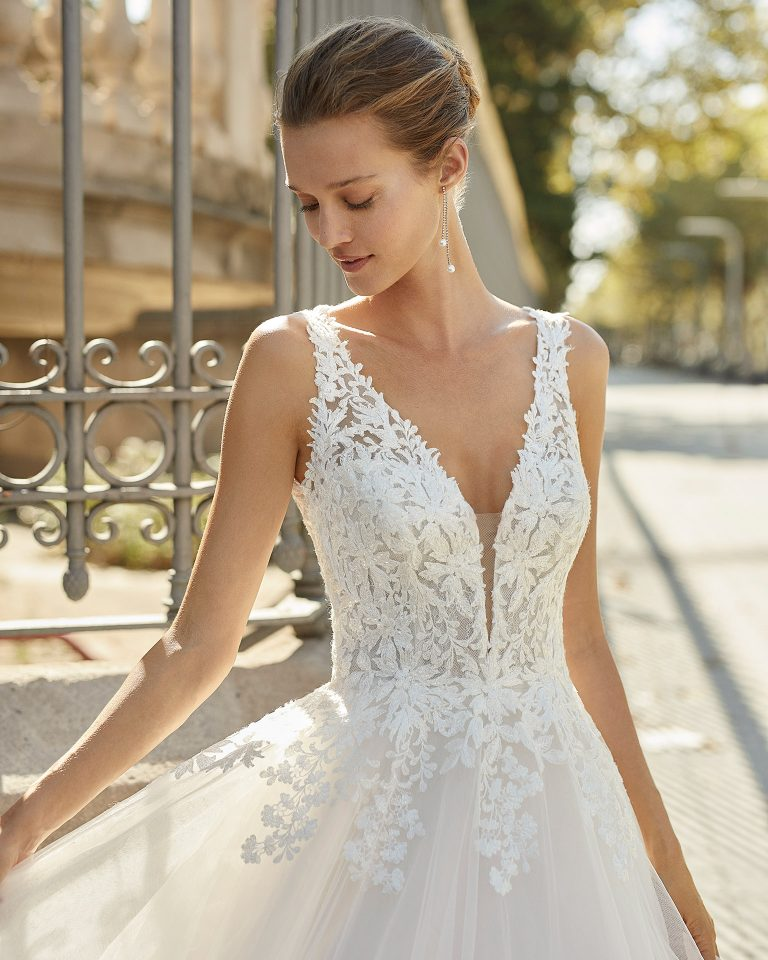 Romantic wedding dress, tulle and beaded lace. Deep-plunge neckline and low back. 2022  Collection.