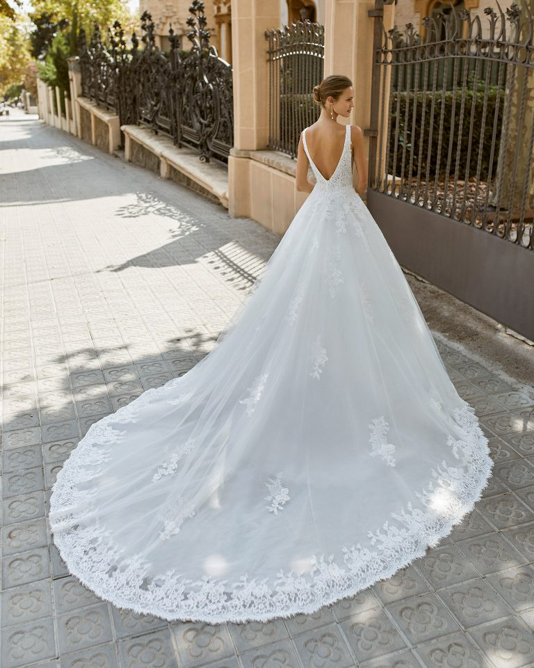 A line wedding dress, tulle, lace and beaded neckline and armholes. Deep-plunge neckline and V-back. 2022  Collection.