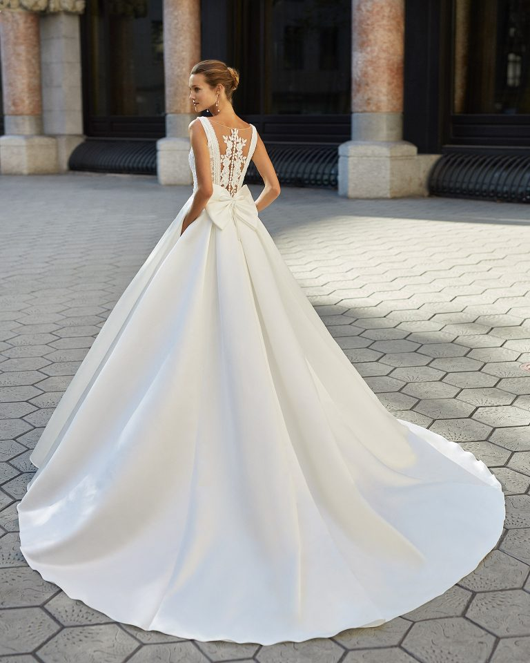 Classic wedding dress, satin, lace and beaded waist. V-neck and lace appliqué back. 2022  Collection.